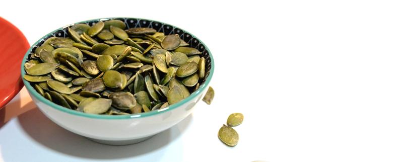 Bowl of shelled pumpkin seeds.