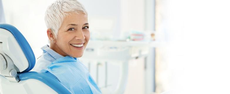 Woman sitting in a dentist chair`