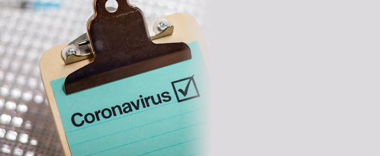 coronavirus word on clipboard with check box
